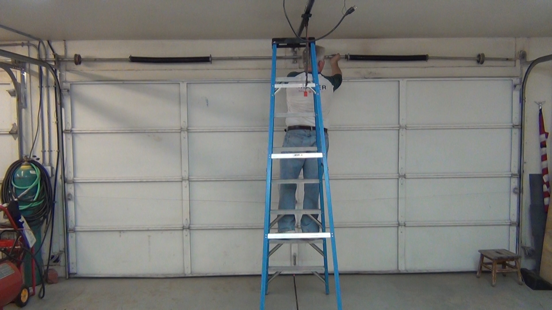 The maintenance requirements of your garage door system for Broken garage door spring repair cost